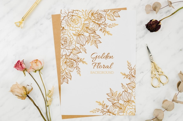 Paper mock-up with golden ornaments Free Psd