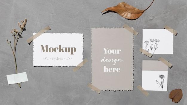 Note di carta e foglie attaccate al muro con nastro adesivo Psd Gratuite