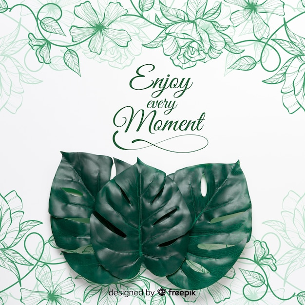 Paper sheet with message and realistic leaves on top Free Psd