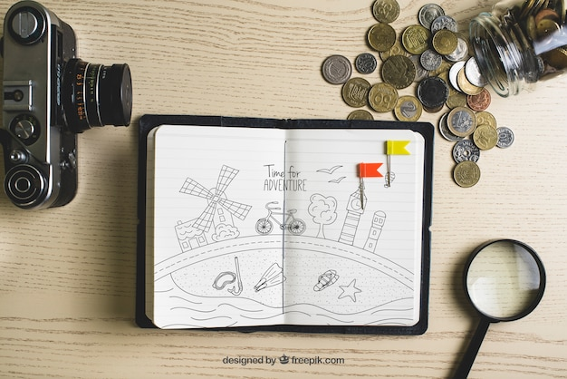 Paper with coins and camera Free Psd