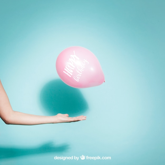 Party concept with arm and balloon Free Psd