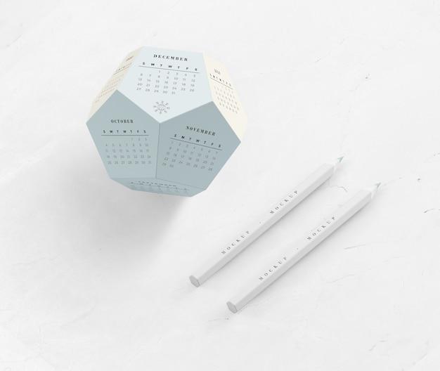 Карандаши и календарь в шестиугольной форме макет Бесплатные Psd