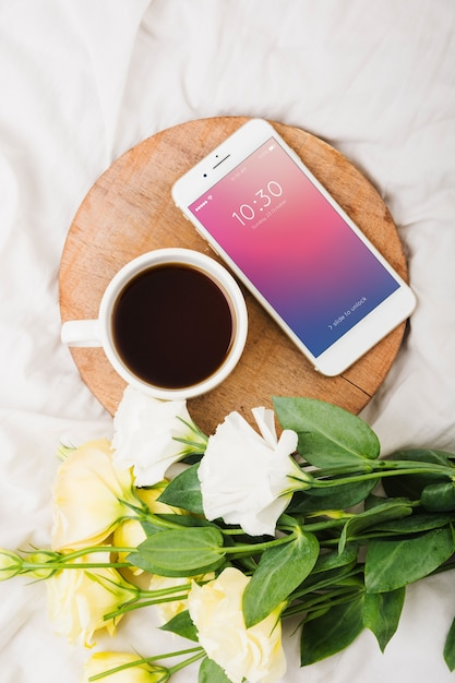 Peony flower mockup with coffee and smartphone Free Psd