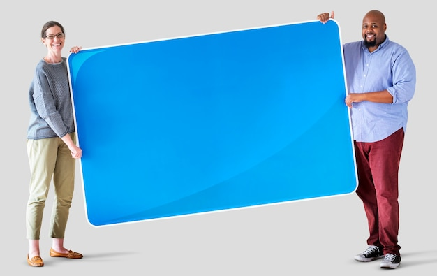 People holding a blank board Free Psd