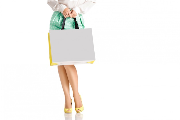 People, sale, black friday concept - woman with shopping bags. Premium Psd
