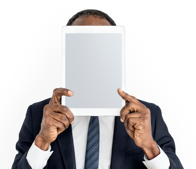 Person holding tablet face concept Free Psd