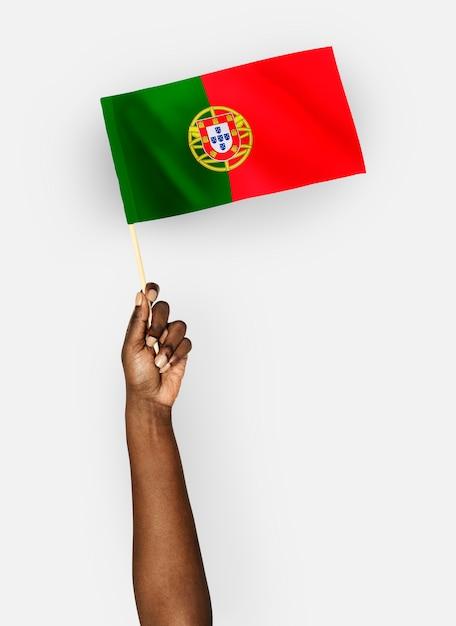 Person waving the flag of portuguese republic Premium Psd