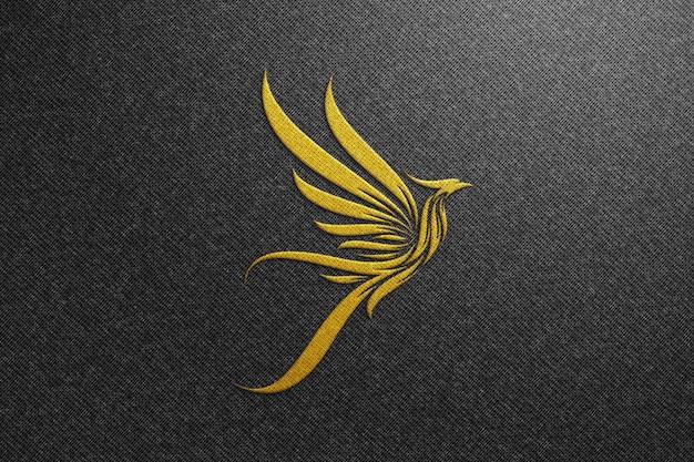 Phoenix logo mockup on black fabric - golden logo mockup Premium Psd