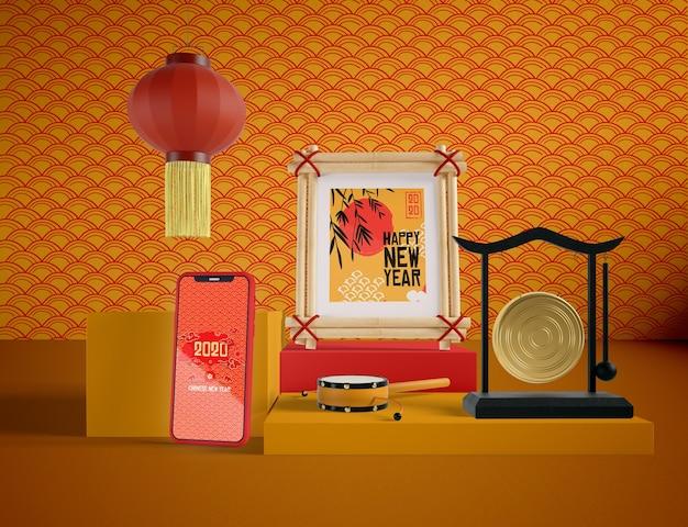 Телефон макет с китайскими традиционными предметами Бесплатные Psd