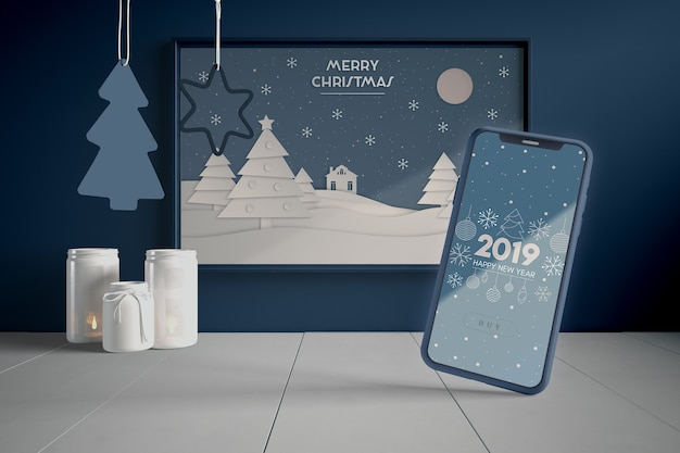 Phone and painting with christmas theme Free Psd