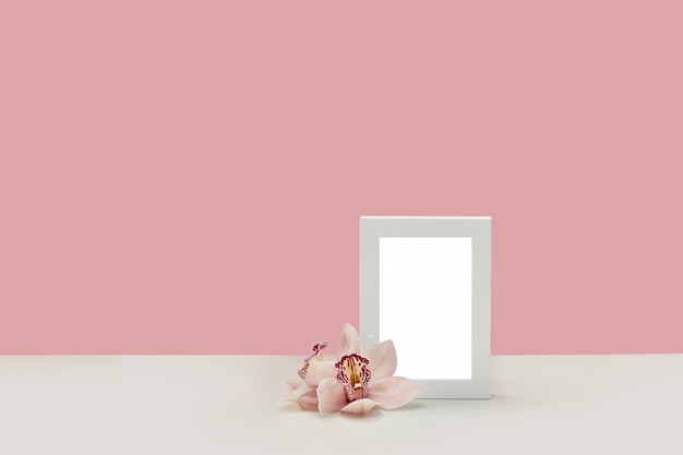 Photo frame decorated with orchid flowers Premium Psd