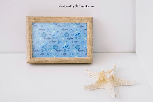 Photo frame mockup with starfish Free Psd
