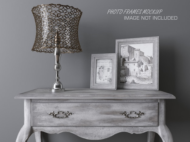 Photo frames mockup on a table with lamp Premium Psd
