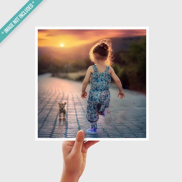 Photo mockup with hand Premium Psd