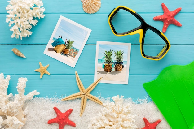 Photos and swimming glasses top view Free Psd