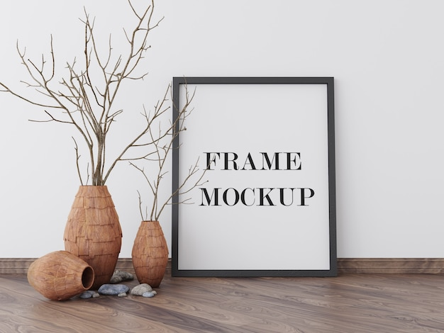 Picture frame mockup beside dry plant Premium Psd