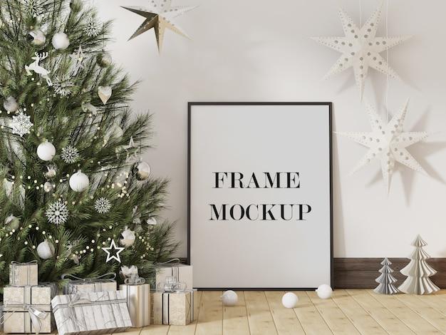 クリスマスツリーの横にある額縁のモックアップ Premium Psd