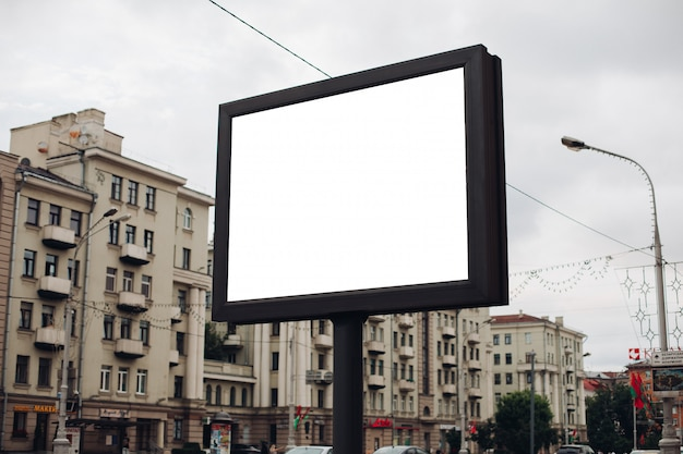 Picture of a large outdoor doard for displaying advertisements next to the avenue Free Psd