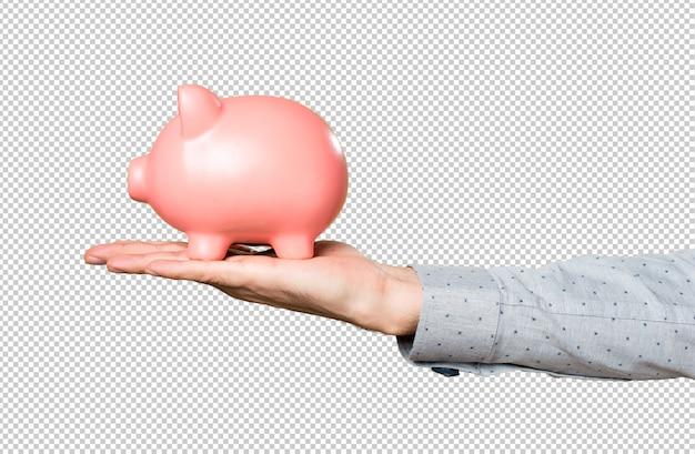 Рука человека держит проведение piggybank Premium Psd