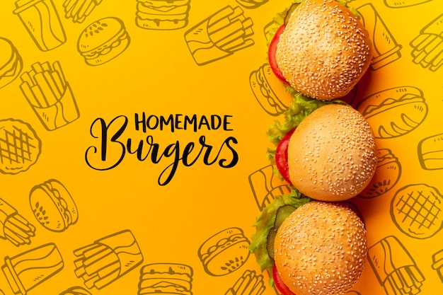 Pile of burgers on fast food doodle background Free Psd