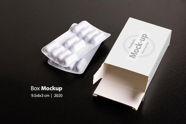 Дот с буханками таблеток на темном фоне макета Premium Psd