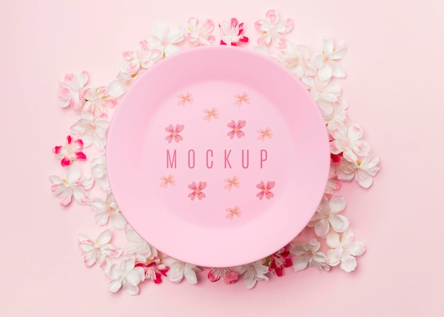Pink plate mockup surrounded by jasmine flowers Free Psd