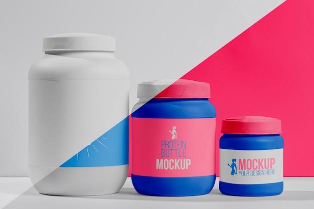 Set rosa di proteine in polvere e pillole per il fitness Psd Gratuite