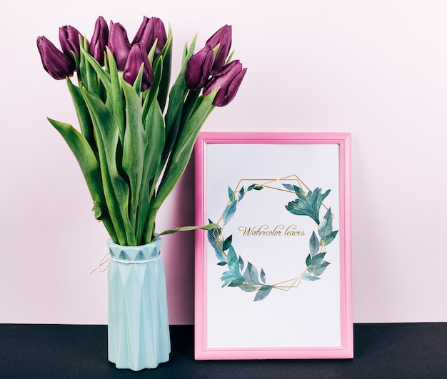 Pink spring frame mockup with bouquet of tulips Free Psd