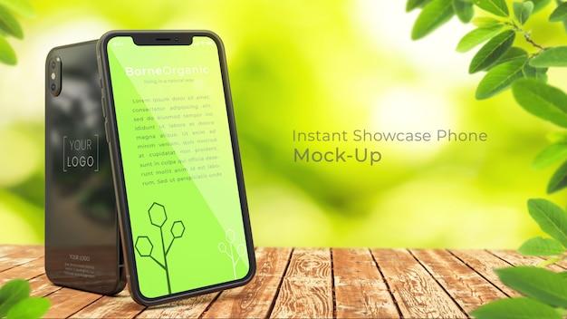 Pixel perfect органический iphone x макет из двух 3d iphone x на деревенском деревянном столе с зеленым, естественным, органическим, размытым фоном дерева с копией пространства psd макет Premium Psd