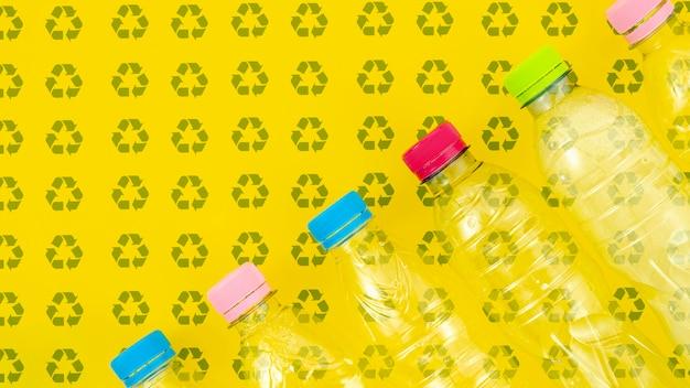 Plastic bottles on background mock-up Free Psd