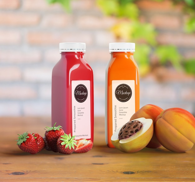Plastic bottles with different fruit or vegetable juices and fruits Free Psd