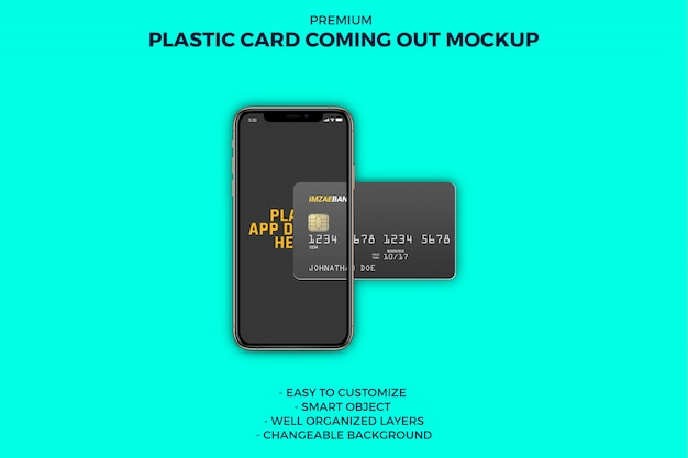 Plastic card coming out from smartphone mockup Premium Psd