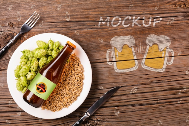 Plate with beer ingredients and bottle of beer Free Psd