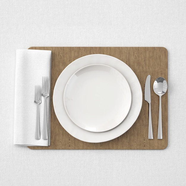 Plates and cutlery over wooden tray Free Psd