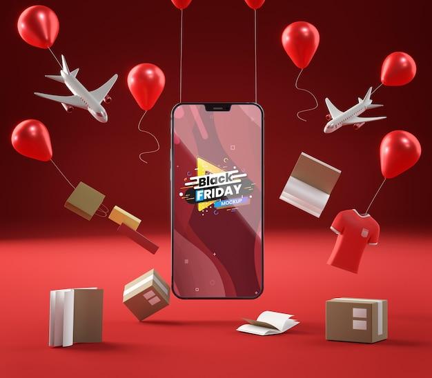 팝업 판매 풍선 및 빨간색 배경에 휴대 전화 무료 PSD 파일