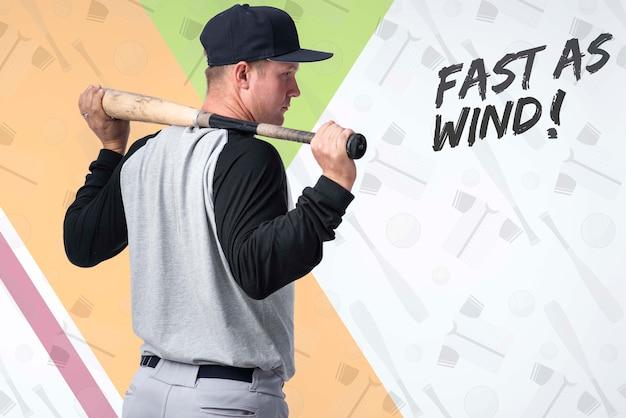 Portrait of baseball player holding a bat Free Psd