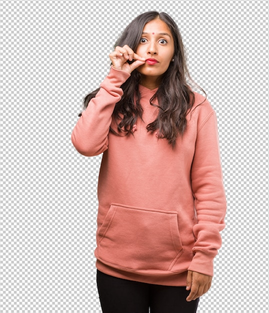 Portrait of fitness young indian woman keeping a secret or asking for silence Premium Psd