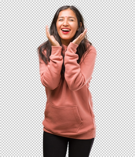Portrait of fitness young indian woman laughing and having fun, being relaxed and cheerful, feels confident and successful Premium Psd