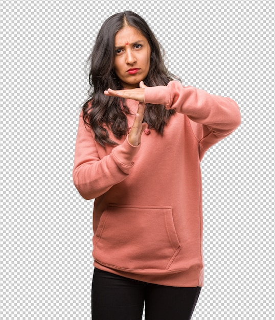 Portrait of fitness young indian woman tired and bored, making a timeout gesture, needs to stop because of work stress, time concept Premium Psd