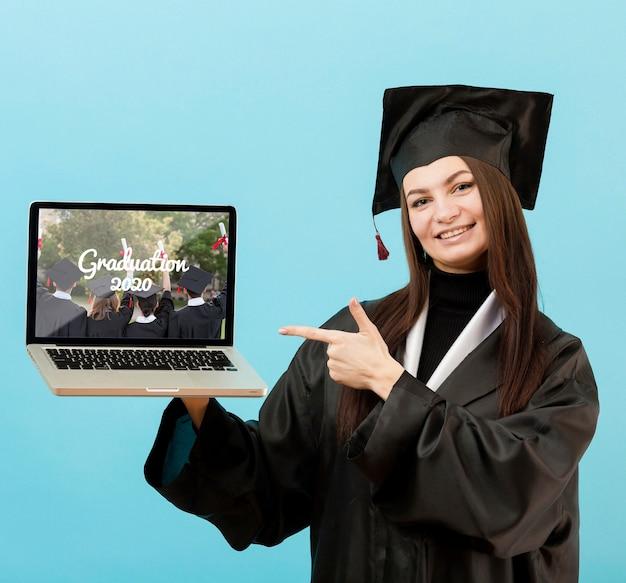 Portrait of student holding laptop Premium Psd
