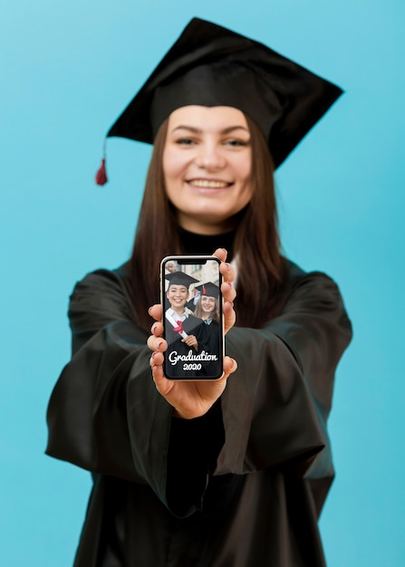 Portrait of student holding mobile phone Free Psd