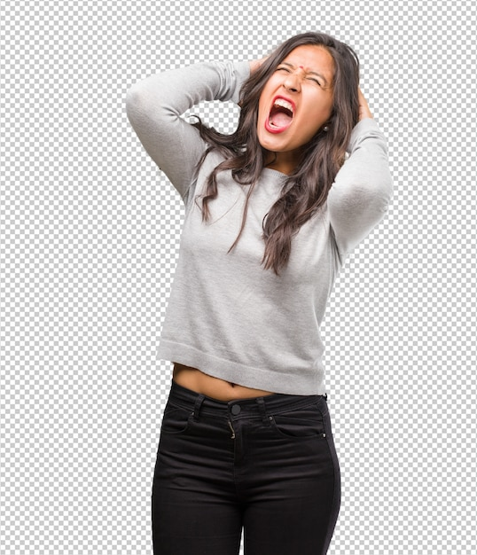 Portrait of young indian woman crazy and desperate, screaming out of control Premium Psd