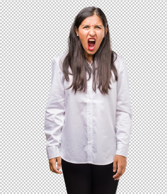 Portrait of a young indian woman screaming angry, expression of madness and mental instability, open mouth and half-opened eyes Premium Psd