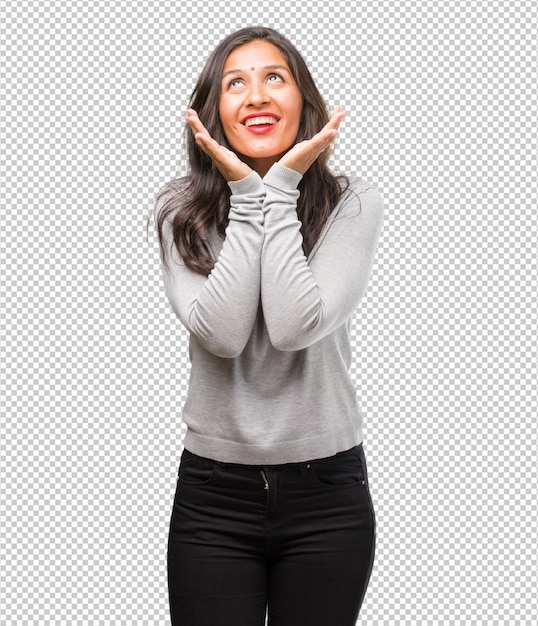 Portrait of young indian woman surprised and shocked, looking with wide eyes, excited by an offer or by a new job, win concept Premium Psd
