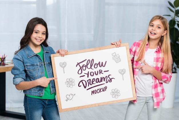 Positive children holding mock-up sign Free Psd