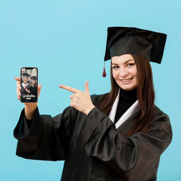 Positive student holding mobile phone Free Psd