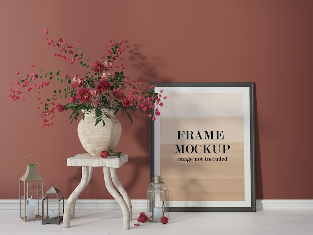 Poster frame mockup beside red flowers Premium Psd
