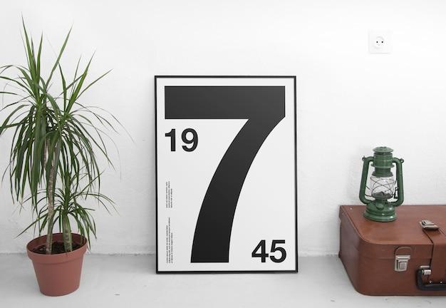 화분에 심은 식물이있는 포스터 프레임 모형 프리미엄 PSD 파일