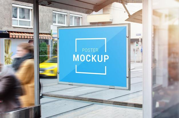 Poster mockup on city bus station. Premium Psd