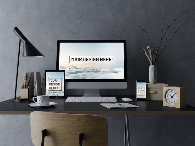 Premium desktop, tablet, and smartphone mock up design template with editable display in black interior workplace Premium Psd